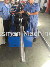 China Rolling Speed 12 - 15m/min Fly Saw Cutting Metal Shutter Door Roll Forming Machine PLC Control System supplier