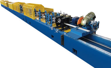China Automatic Punching PU Shutter Door Roll Forming Machine Flat Injection 24 * 0.6 * 0.9m factory
